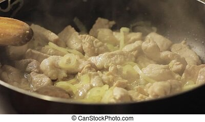fry meat with vegetables, hotpot on a home kitchen.