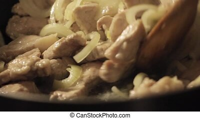 fry meat with vegetables, hotpot on a home kitchen