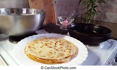 fry pancakes in a skillet oh a home kitchen. domestic...