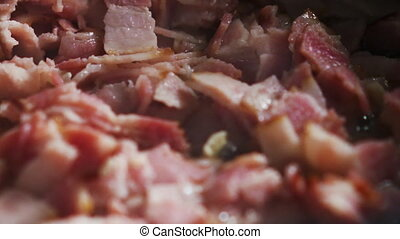 frying bacon on a pan for carbonara close up 180fps prores ...