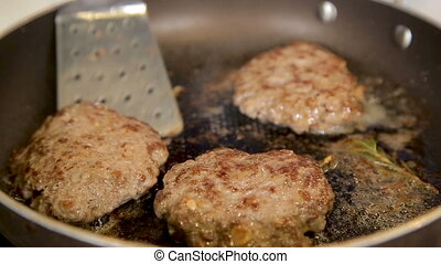 Frying beef cutlets in a pan - Chef is frying beef cutlets ...