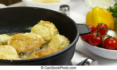 Frying Chicken Breast Rolls - frying chicken breast roll on...