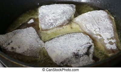 Frying coated flounder in flour after cleaning and gutting...