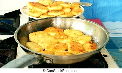 Frying cottage cheese pancakes on gas stove with ready cakes...