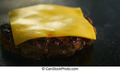 Frying cutlets with cheese - Closeup of a burger cutlet with...
