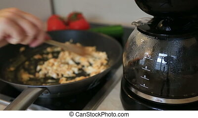 Frying egg and coffee
