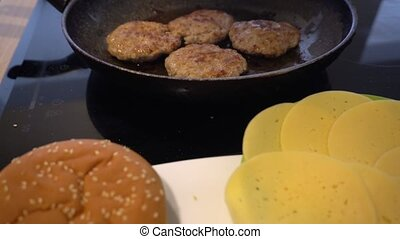 Frying meat balls in pan and other ingredients for burger. Gimbal movement