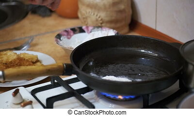 Frying Meat Chops on a Frying Pan in the Home Kitchen. Slow...