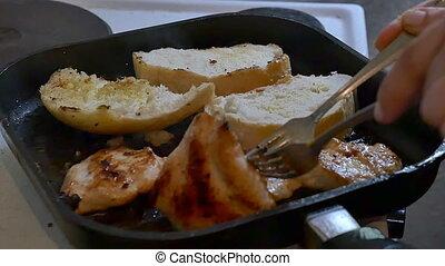 frying meat in a pan