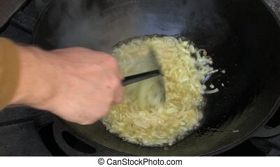 Frying onion in Wok  - Steam from Frying onion in Wok