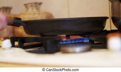 Food Preparation on Gas Stove Ignition - Frying pan on a gas...