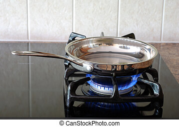 Frying pan on a gas stove - Cooking in a frying pan on a gas...