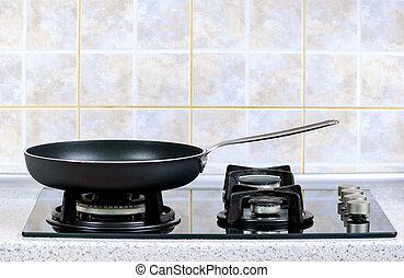 frying pan on the gas stove - the frying pan taken closeup...