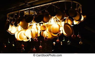 Frying pan. Pans hang on the wall.