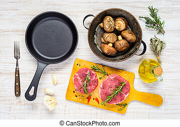 Frying Pan, Raw Meat and Mushrooms with Seasoning