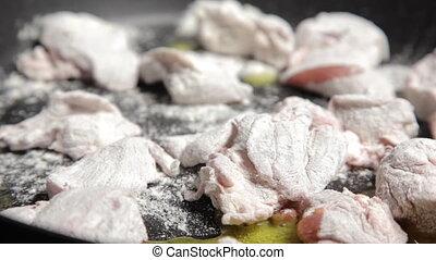 Frying pork on a pan