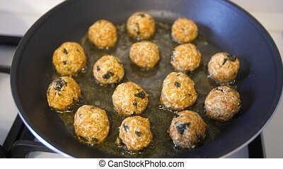 Frying vegetarian snacks on frying pan