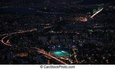 FSM Bridge - aerial view night city traffic at Istanbul...