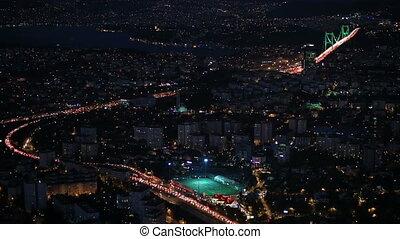 FSM Bridge - aerial view night city traffic at Istanbul...