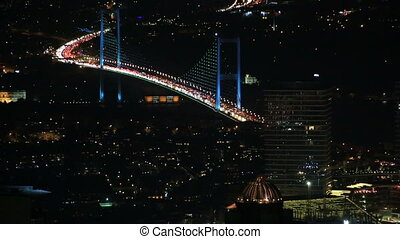 FSM Bridge - traffic on the Fatih Sultan Mehmet Bridge at...