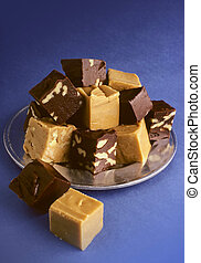 Fudge on blue - Brown and beige fudge on silver plate shot ...