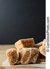 Fudge Pieces on Wood with Black Background
