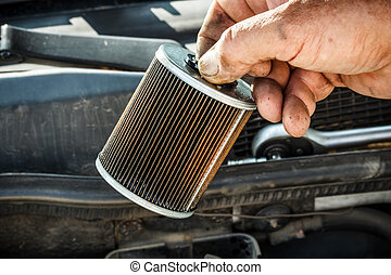 Fuel filter - Car mechanic replace the fuel filter