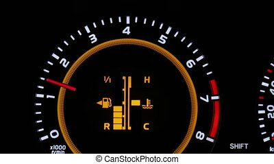 Fuel indicator of a car going down on the dashboard, decreasing bars, fuel running low