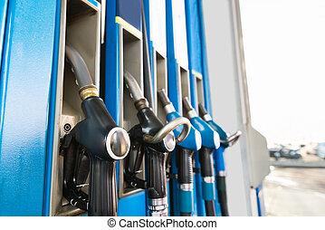 Fuel Pumps At A Gas Station - Close-up Of Fuel Pump Nozzles...