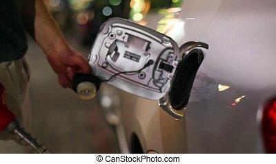 Fuel Station Filling up - Filling fuel into a car