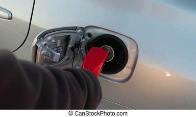 Fuel station nozzle - Filling fuel into a car