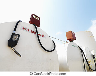 Fuel tanks and pumps. - Fuel tanks labeled unleaded and ...