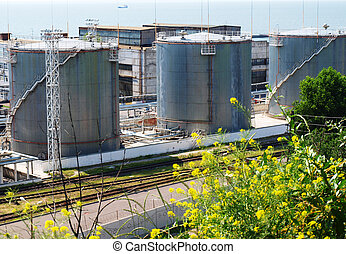 Fuel oil terminal tanks in the port on the sea