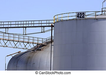 Fuel Tanks - Large fuel tanks standing in a yard