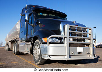 Fuel Truck - A blue fuel truck with two tanks behind.