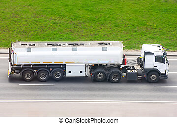 Fuel Truck Drives on the highway with a tank trailer.