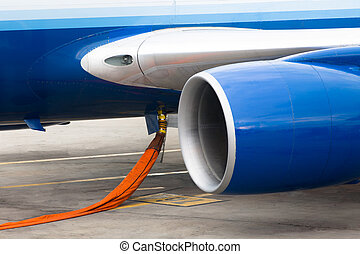 Fuelling the Jet Engine - Orange hose ready to refill...