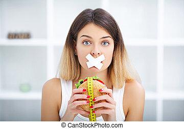 fuerza de voluntad, dieta, chatarra, pero, boca, retrato de mujer, hamburguesa, nutrición, skochem, wants, pegado, alimento, concepto, diet., comer