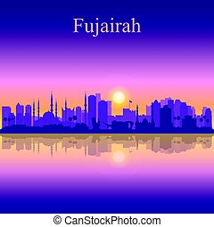 Fujairah silhouette on sunset background
