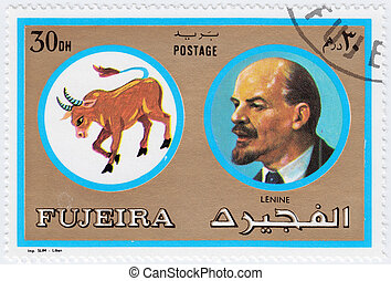FUJEIRA - CIRCA 1971 : stamp printed in Fujeira, Zodiac Signs of Famous People  shows Lenin was a Russian revolutionary,, circa 1971
