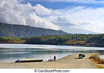 Fuji and Lake Saiko - Fuji Mountain towers over Lake Saiko ...