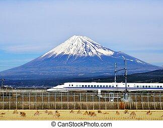 Fuji and Train - A bullet train passes below Mt. Fuji in ...