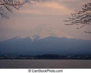 Fuji Mountain in Japan at sunset scene with lake