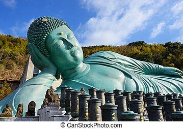 FUKUOKA - FEBRUARY 9: The Reclining Buddha of Nanzoin Temple February 9, 2013 in Fukuoka, JP. The temple was moved to the spot in 1899 from Wakayama Prefecture.