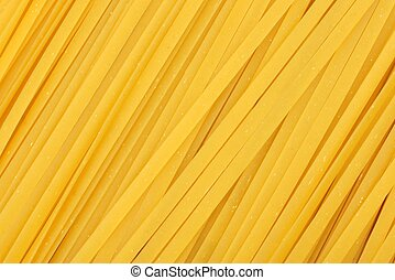 Full background of dried uncooked linguine pasta