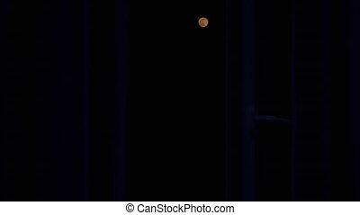 Full Bloody Moon Rises in the Dark Sky at Night. Full Moon. Zoom