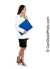 Full body asian female medical doctor holding a clipboard standing isolated on white background.