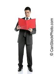 Full body businessman reading red folder at studio