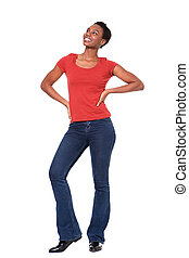 Full body confident black woman standing and smiling on white background