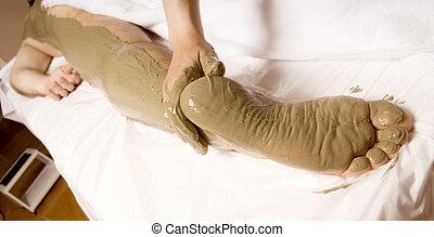 Full body mud wrap - man client getting a Full body mud wrap